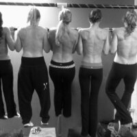 crossfit-girls-in-a-row-doing-pullups-topless-1024x701